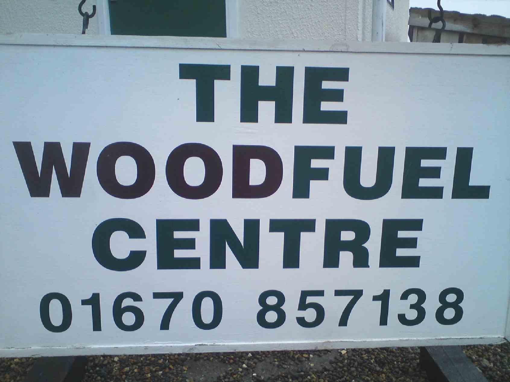 "notice board displaying ""The Woodfuel Centre, telephone 01670 857138"""